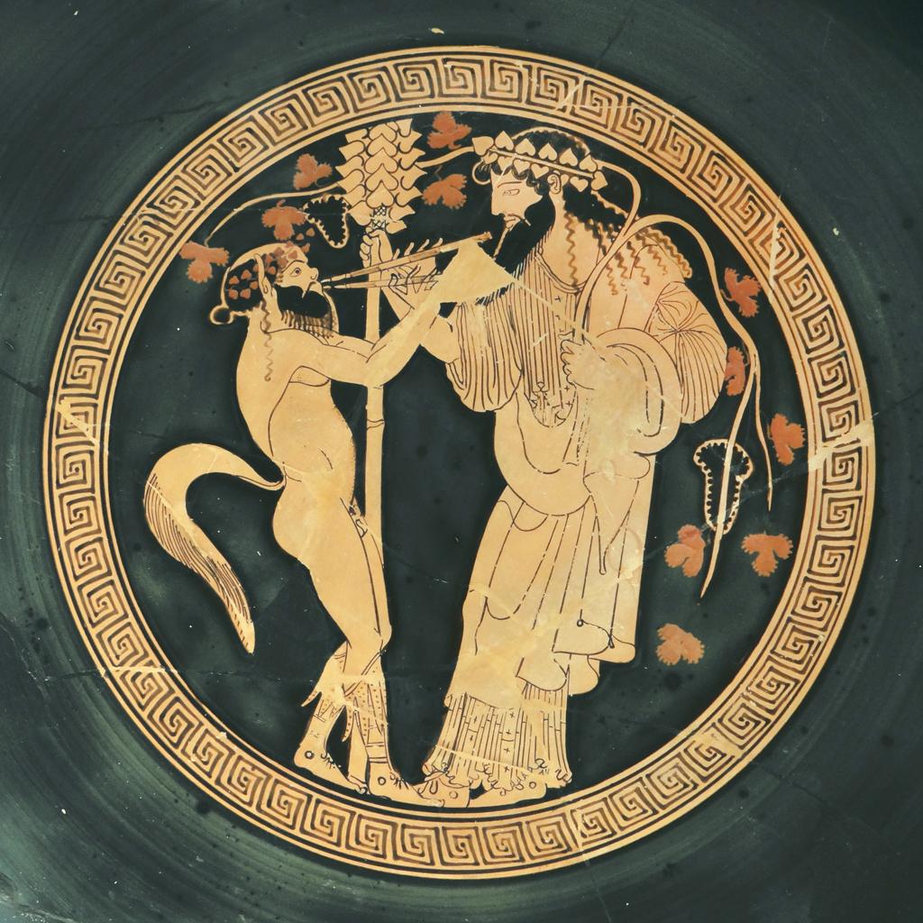 Intérieur d'une coupe à boire peinte par Makron : Le culte de Dionysos Satyre jouant de l'Aulos en l'honneur de Dionysos Potier : Hieron environ 480 av. J.C. Kylix, coupe à boire attique à figure rouge Terre cuite Vulci (Italie), Altes Museum, Berlin